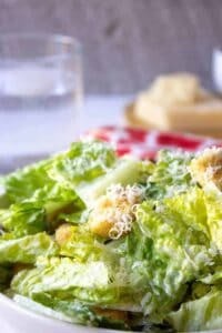 A green salad with a creamy dressing and croutons.