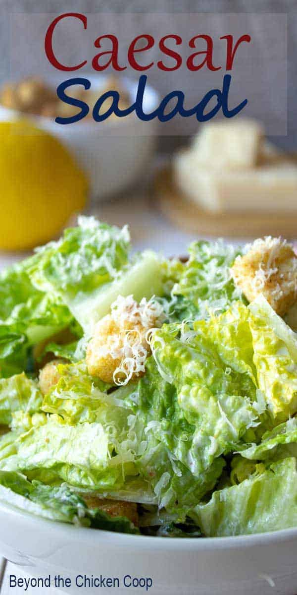 Caesar Salad topped with croutons and parmesan cheese.