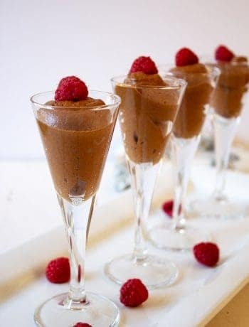 Chocolate Mousse in small glasses topped with a raspberry