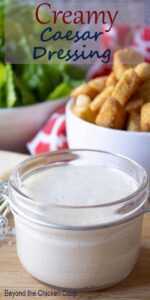 Creamy Caesar Salad dressing in a small jar.