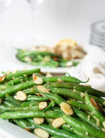 Green bean almondine topped with toasted almonds.