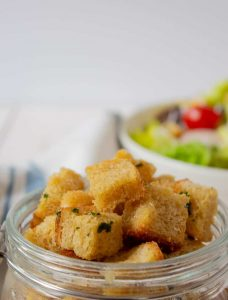 Homemade croutons in a glass jar.
