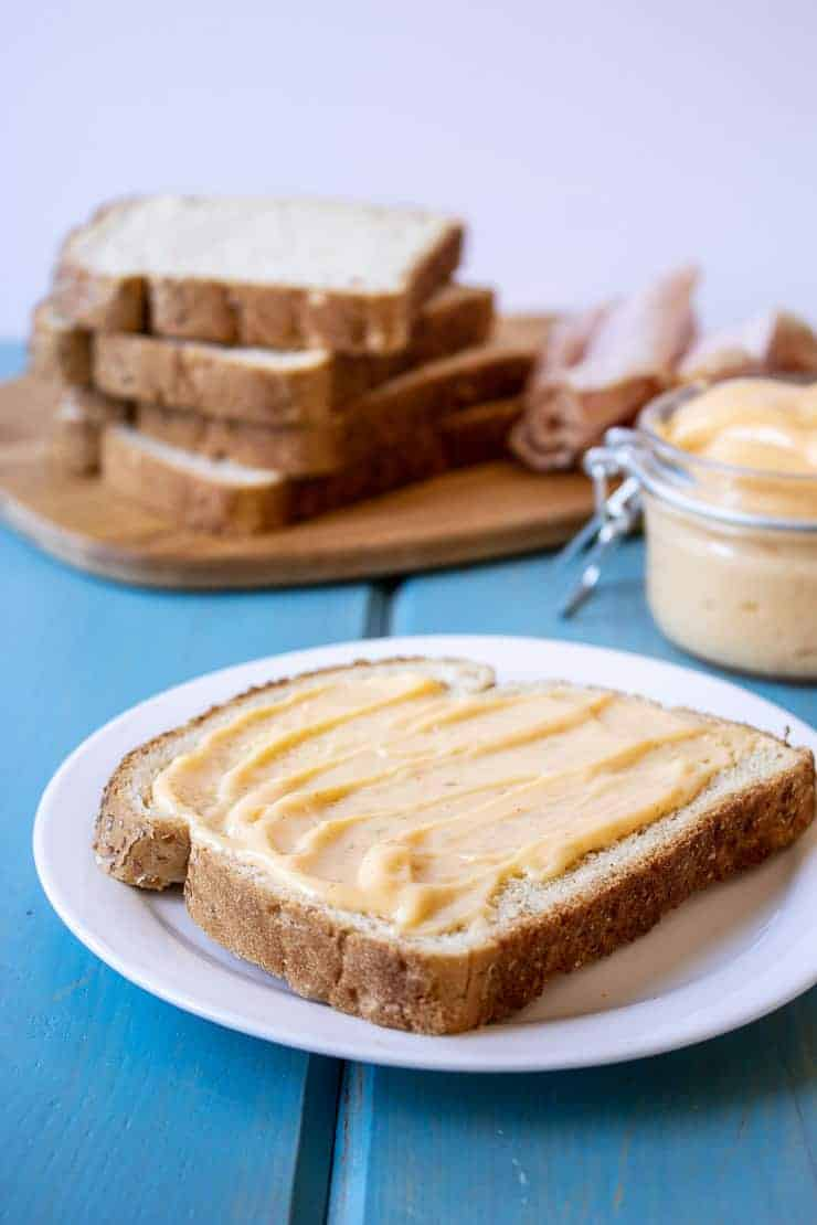 A piece of bread spread with Homemade Miracle Whip.