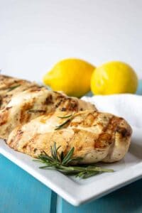 Lemon Rosemary Grilled chicken on a white plate