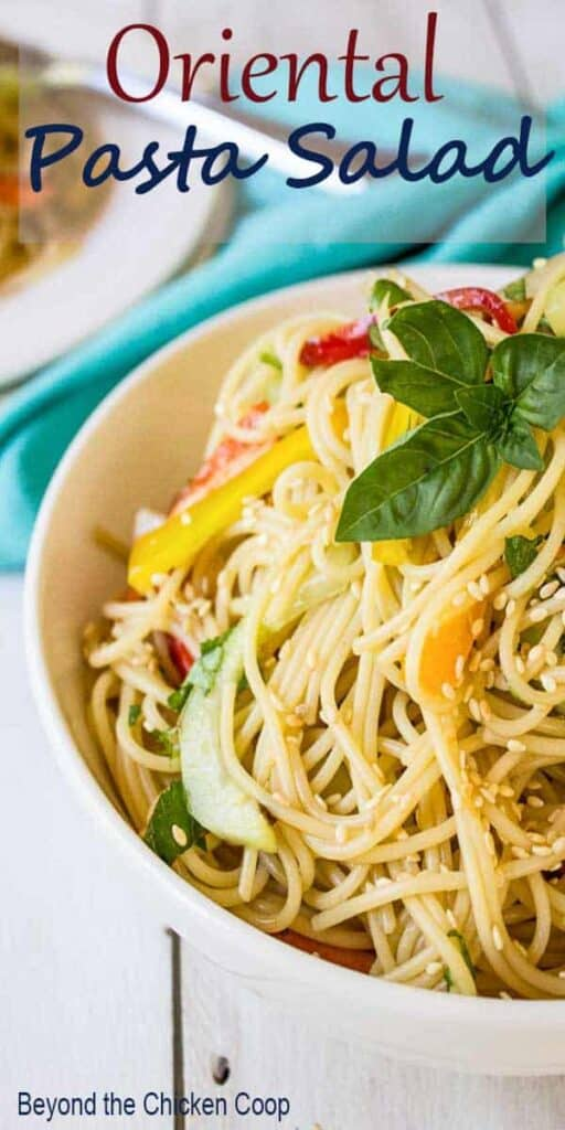 Oriental pasta salad topped with fresh basil.