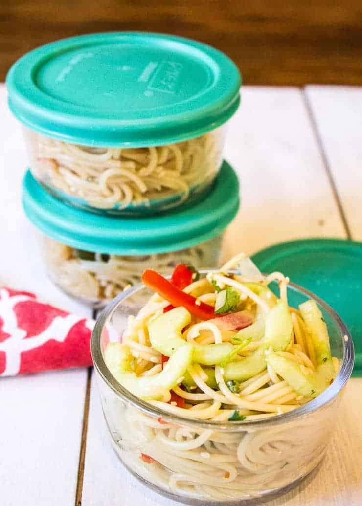 Pasta salad in small glass containers.