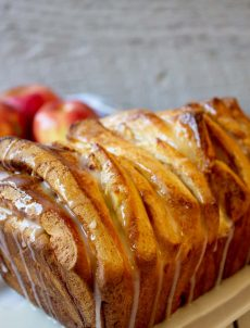 Apple Cinnamon Pull Apart Bread topped with a powdered sugar glaze.