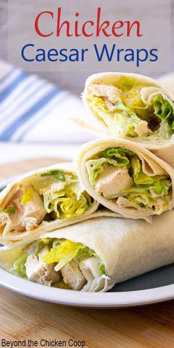 Tortillas wrapped around chicken and caesar salad.