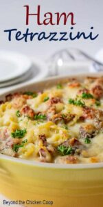A yellow casserole dish filled with ham tetrazzini