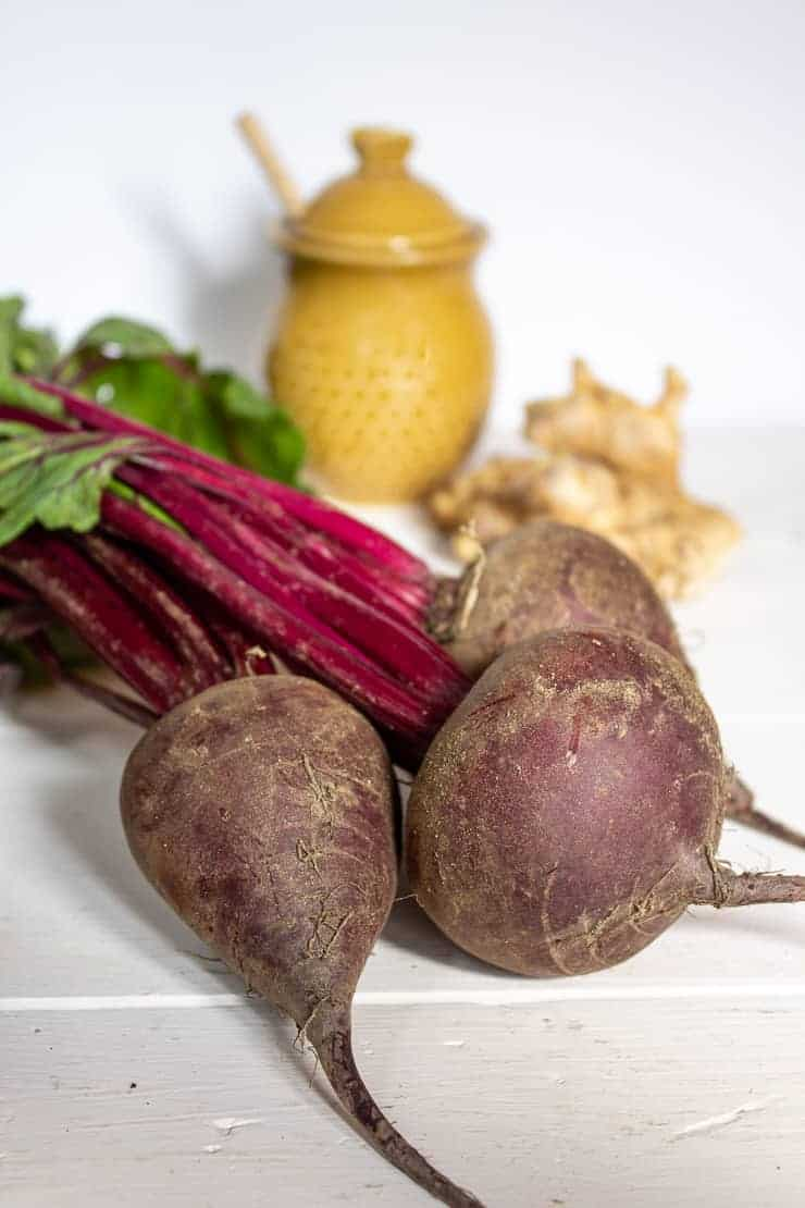 Fresh beets with stalks and ginger root.