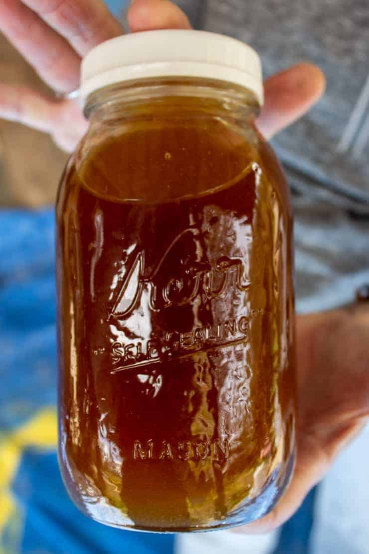 A canning jar filled with freshly spun honey.
