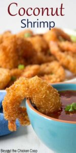 Crispy shrimp resting on the side of a turquoise bowl.