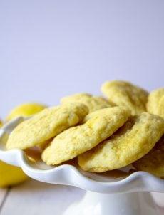 Lemon Sugar cookies arranged in a circle on a cake platter.