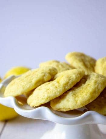 Lemon Sugar cookies arranged in a circle on a cake platter.