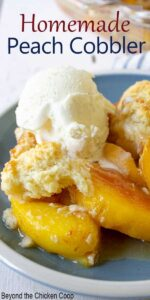 A blue plate with peach cobbler and a scoop of ice cream.
