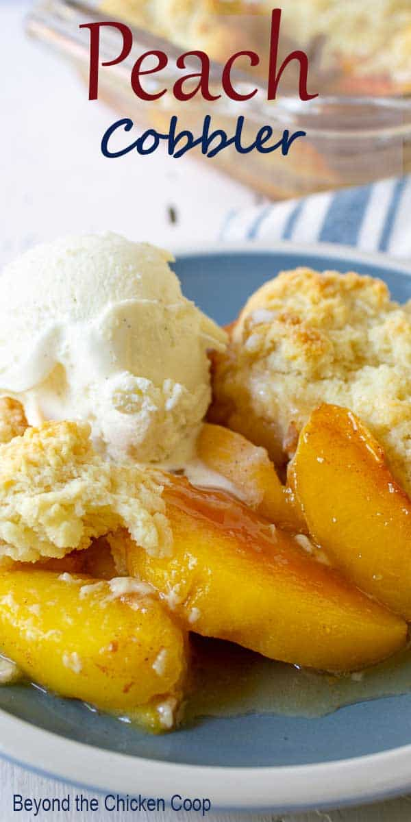 Peach slices topped with a biscuit and vanilla ice cream.