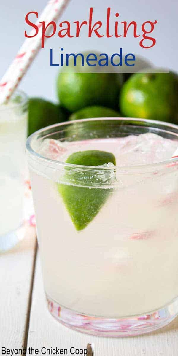 A glass with ice and fresh limes.