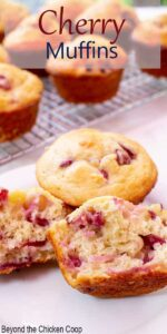 Cherry muffins on a plate with one muffin split in half.