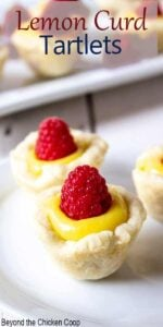 Mini lemon dessert topped with a fresh raspberry.