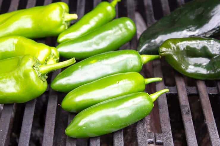 Jalapeno peppers on a gas grill.