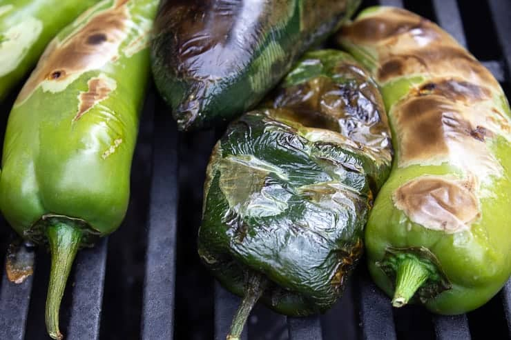 Roasted peppers on a grill.