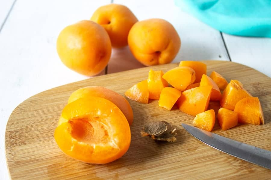 Fresh apricots on a cutting board.
