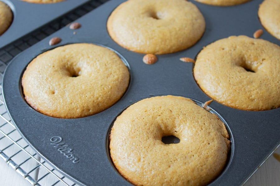 Cooked donuts in a pan.