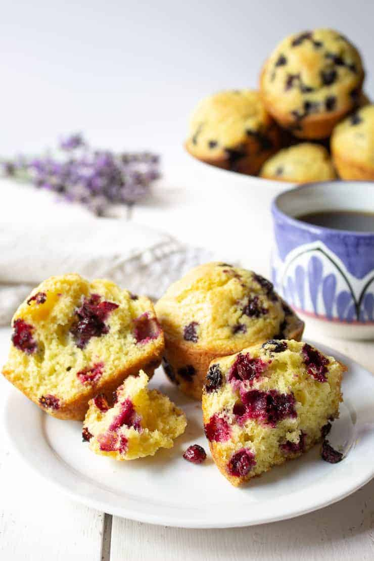 Muffins filled with huckleberries on a plate.