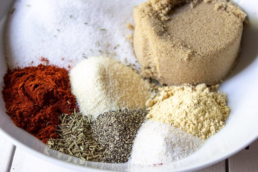 Sugar and spices in a white bowl.