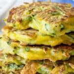 A stack of zucchini fritters with cheese.
