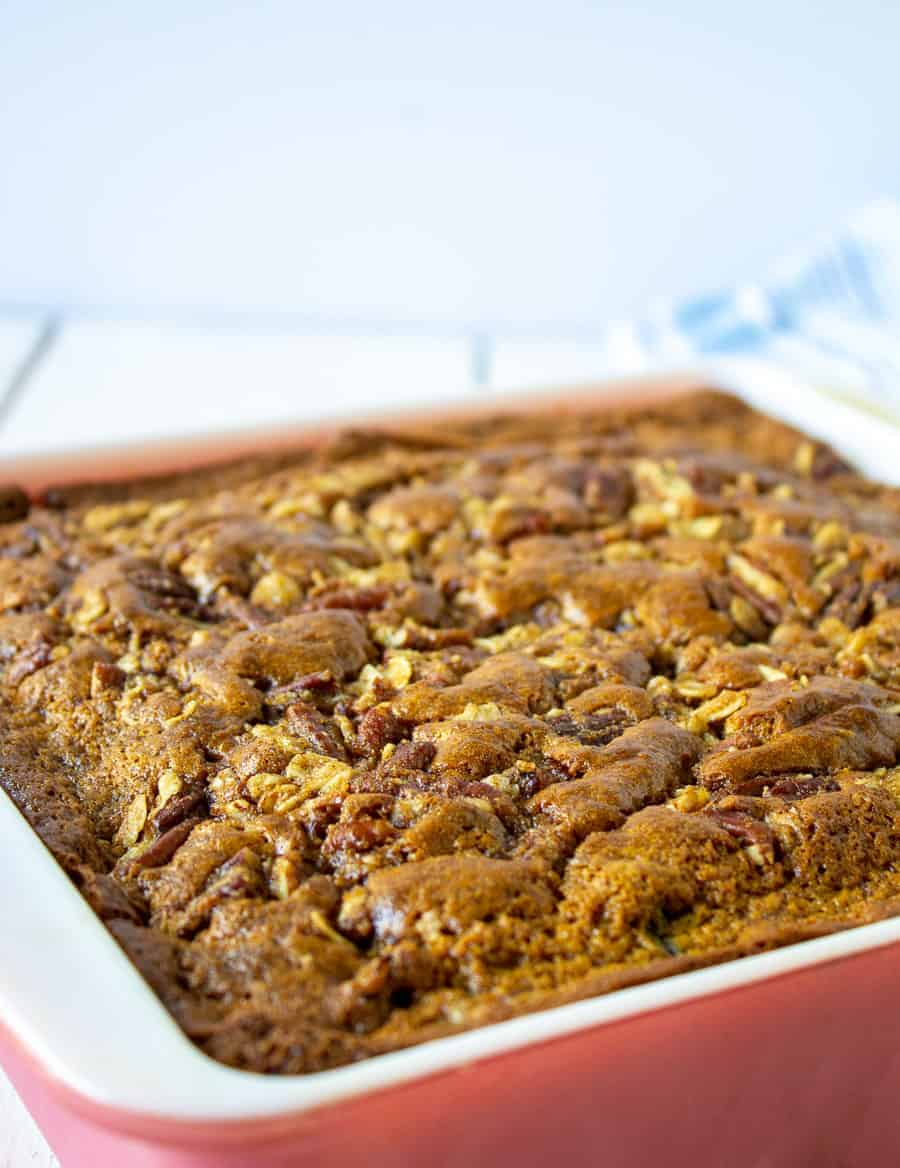 A square casserole dish filled with a blueberry banana coffee cake.