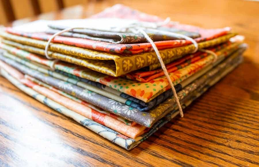 A stack of colored beeswax covered fabric.