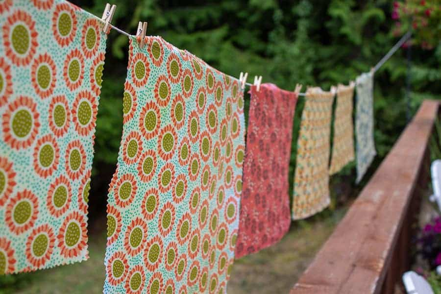 Beeswax Wraps hanging from a line.