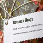Beeswax wraps folded and stacked and tied together with string.