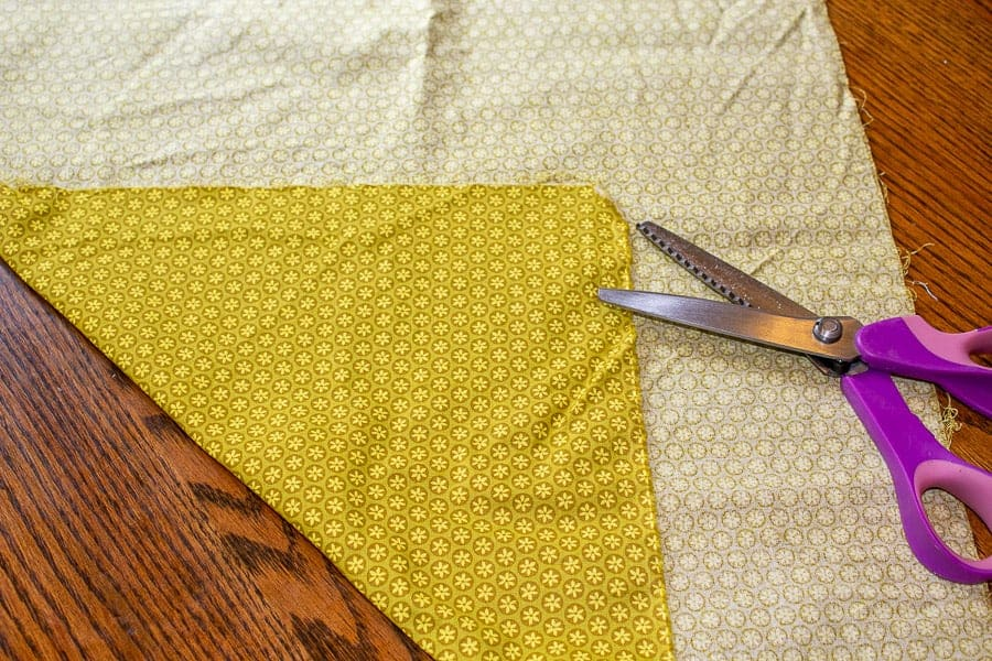 Patterned material cut with pinking shears.