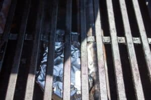 Wood chip packet on grill.