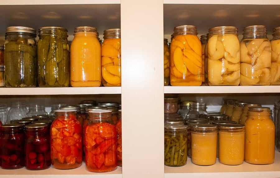 A pantry filled with canned goods.