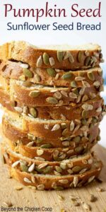 A tall stack of sliced bread studded with pumpkin seeds.