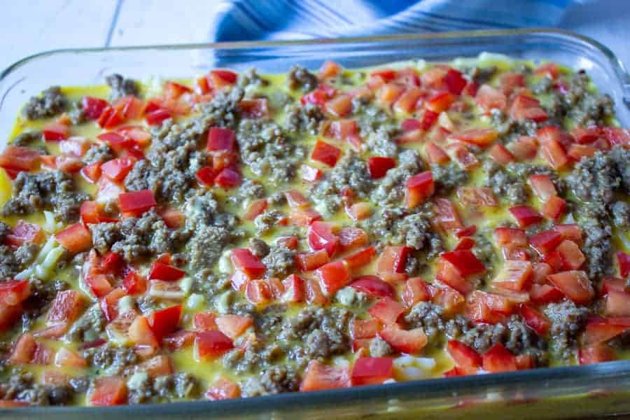 Uncooked breakfast casserole in a glass baking dish.