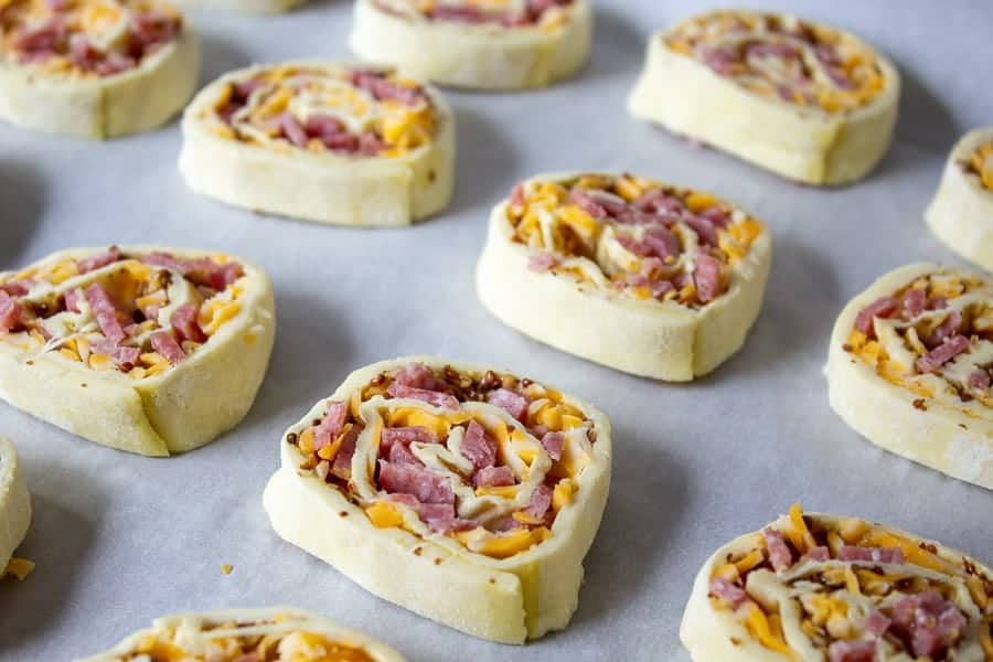 Salami and Cheese Pinwheels on a baking sheet.