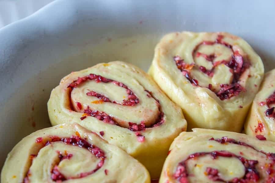 Slices of sweet rolls in a baking dish.