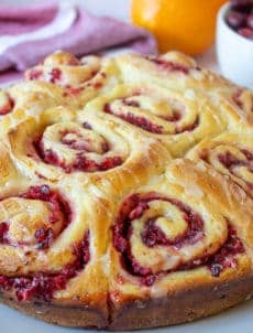 Homemade cinnamon rolls filled with chopped cranberries.