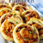 A platter filled with appetizers with puff pastry and cheese.