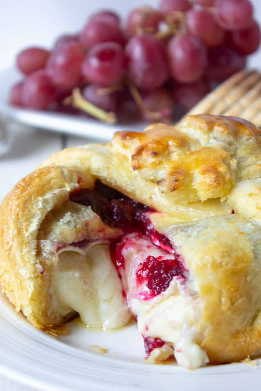 Puff pastry filled with melted brie and cranberry sauce.