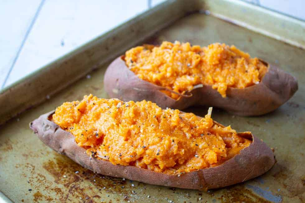 Mashed sweet potatoes in potato skins.
