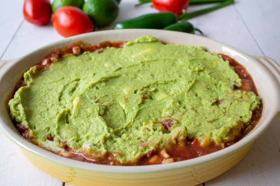 A layer of guacamole over salsa.