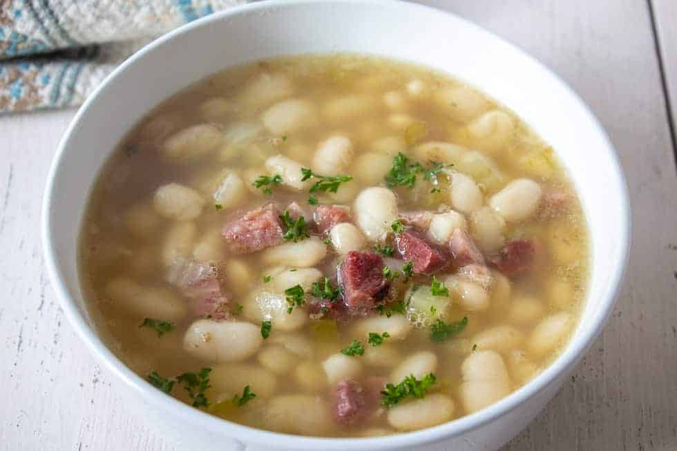 White beans and ham in a broth.
