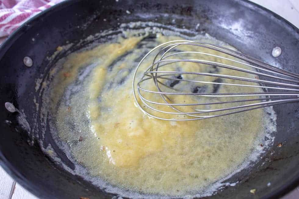 Butter and flour mixed together in a pan.