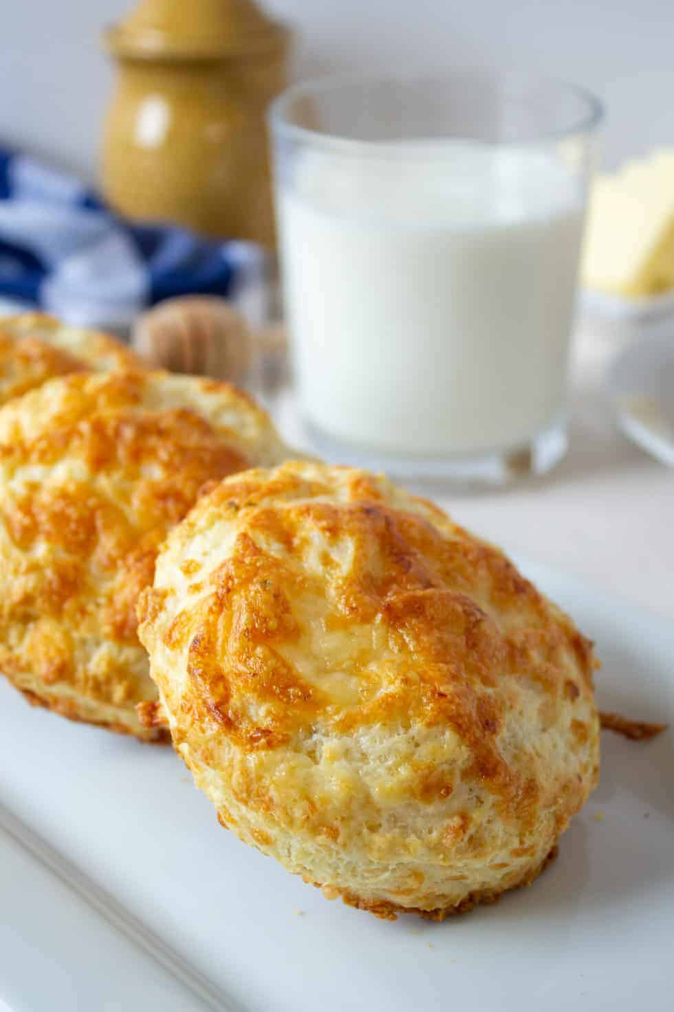 Pepper Jack Biscuits on a long white plate.