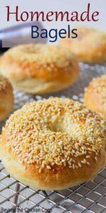 Sesame bagels on a baking rack.